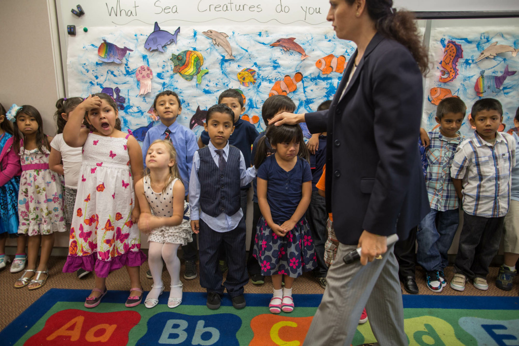 Students line up to sing a song before their parents arrive for a graduation ceremony in a class of mixed kindergarten and transitional students at Stanley Mosk Elementary School in Winnetka.