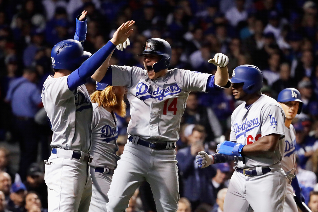 CHICAGO, IL - OCTOBER 19:  Enrique Hernandez #14 of the Los Angeles Dodgers celebrates with teammates after hitting a grand slam in the third inning against the Chicago Cubs during game five of the National League Championship Series at Wrigley Field on October 19, 2017 in Chicago, Illinois.  (Photo by Jamie Squire/Getty Images)