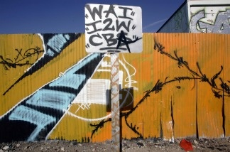 Gang related graffiti is painted on a fence in South Central Los Angeles on Nov. 28, 2006. The recent gang-related shooting in which a 5-year-old boy was killed, is reminiscent of the gangland turf wars of the 1980s and early '90s.