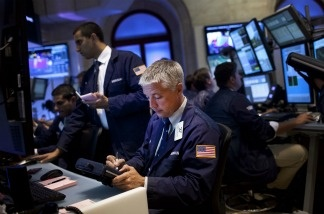 Traders work on the floor of the New York Stock Exchange during afternoon trading.