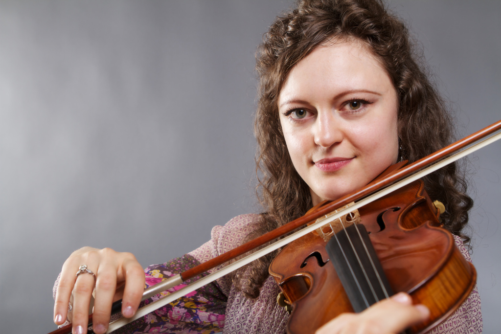 UC Irvine violinist Iryna Krechkovsky with a 1689 Baumgartner Stradivari, valued at $5 million.
