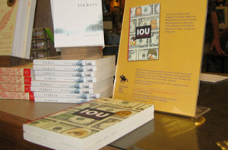 IOU, one of the books published by the Concord Free Press, is on display at The Concord Bookshop in Concord, Mass. As part of the publisher's generosity-based publishing model, patrons can take the book for free, but they're asked to make a donation to charity.