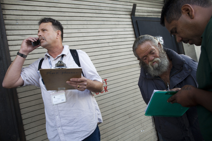 Mark Meeker, left, and Gabriel (Gilbert) Jimenez help George Phillippi, center, get into a social services program for veterans. Phillippi is a Vietnam veteran who found himself on Skid Row after traveling to Los Angeles to find his daughter and grandchildren.