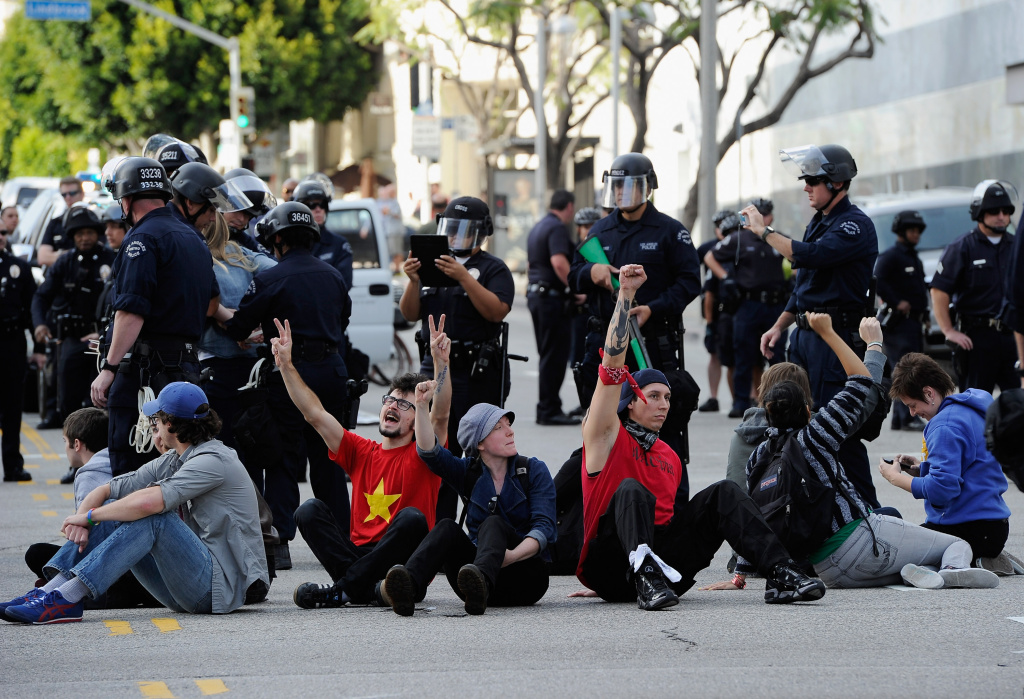 Eleven UCLA students sit in a circle in the intersection of Westwood and Wilshire boulevards as part of a protest of bank practices and rising fees at public universities before they were arrested by the Los Angeles Police Department.