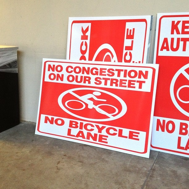 Anti-bike lane signs like these have been popping up on storefront windows in Colorado Boulevard in Eagle Rock.