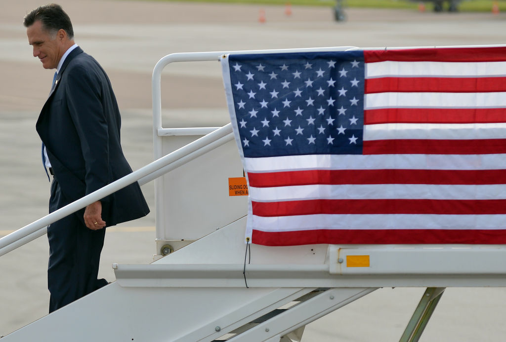 US Republican presidential candidate Mitt Romney disembarks from his campaign plane upon arriving in Tampa, Florida, on August 29, 2012.
