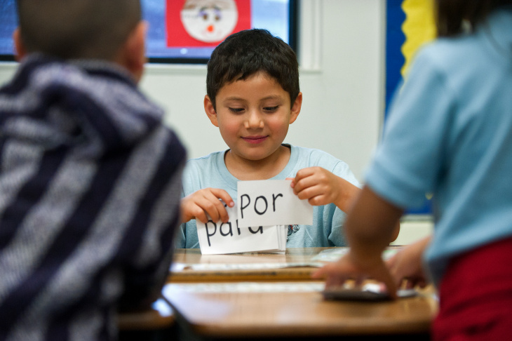 Transitional kindergarten dual language student Jesus Lopez goes through a keycard exercise with his classmates on Wednesday, March 20 at Foster Elementary School. Half of the school is in a dual language program, and the other half of the students are taught in English only.