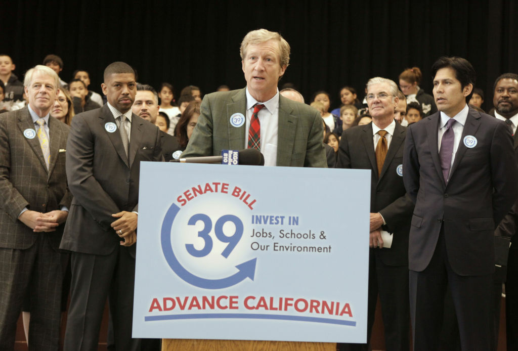 Billionaire Tom Steyer, the chief financier behind the Proposition 39 campaign, discusses a proposed bill to fund energy efficiency projects at schools in California's poorest communities, during a news conference at Mark Twin Elementary School in Sacramento, Calif., Tuesday, Dec. 4, 2012.  The bill, co-authored by state Sen. Kevin de Leon, D-Los Angles, right, and Senate President Pro Tem Darrell Steinberg, D-Sacramento,  would use money from last month's voter approved initiative, Proposition 39, that requires $500 million for five years be used for clean air project.