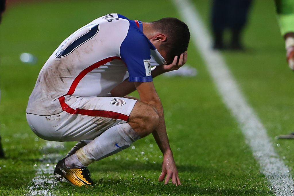 Christian Pulisic of the United States mens national team reacts to their loss to Trinidad and Tobago during the FIFA World Cup Qualifier match between Trinidad and Tobago at the Ato Boldon Stadium on October 10, 2017 in Couva, Trinidad And Tobago.