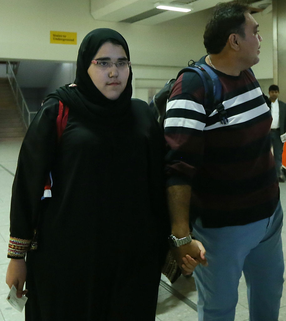 Female Saudi Judo athlete Wojdan Shaherkani (L) arrives with her father at Heathrow airport in preparation for the 2012 London Olympic Games. Saudi Arabia's decision to allow two female athletes to compete at the Olympic Games overturns a decades-old taboo imposed by the conservative Muslim monarchy which still bars women from sports at home.
