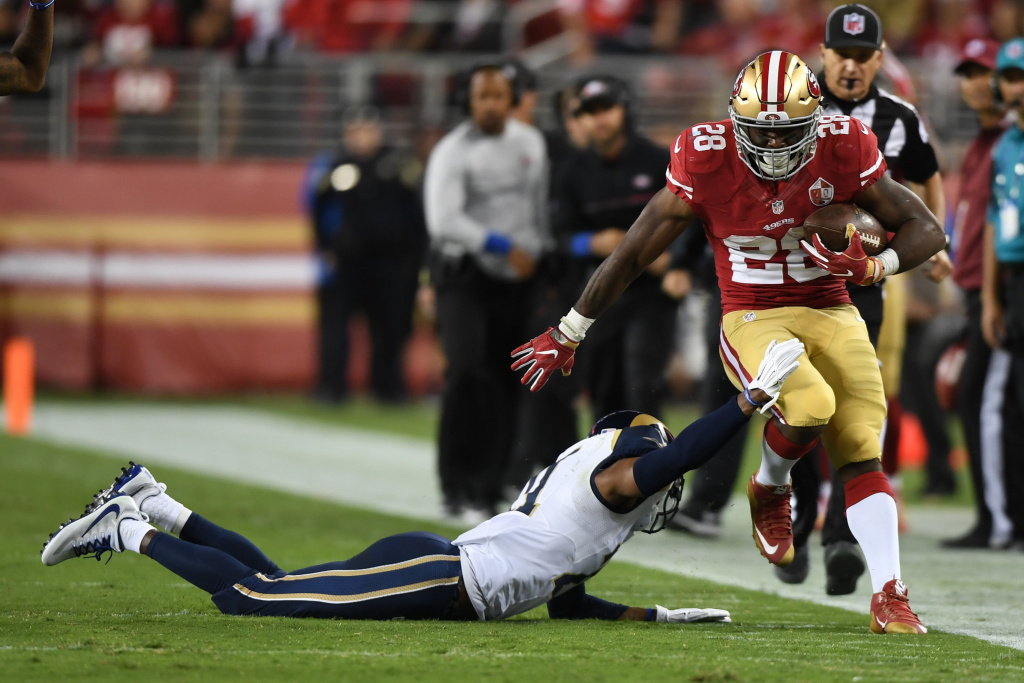 Carlos Hyde #28 of the San Francisco 49ers rushes with the ball against the Los Angeles Rams during their NFL game at Levi's Stadium on September 12, 2016.