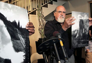 Rick Norsigian holds up a photograph made from a glass negative shot by the late photographer Ansel Adams during a news conference in Beverly Hills, on Tuesday July 27,2010. A lawyer says the trove of old glass negatives found in a garage sale for 45 dollars by Norsigian a painter from Fresno, Calif. has been authenticated as the work of photographer Ansel Adams and are worth at least $200 million.