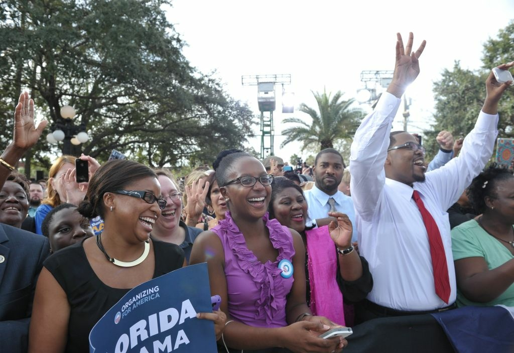 Supporters cheer as US President Back Obama speaks during a campaign rally at Ybor City Museum State Park on October 25, 2012 in Tampa, Florida. Obama returns to his home turf of Chicago, to cast an early ballot for the November 6 election, a brief detour during his eight-state, 40-hour campaign tour.