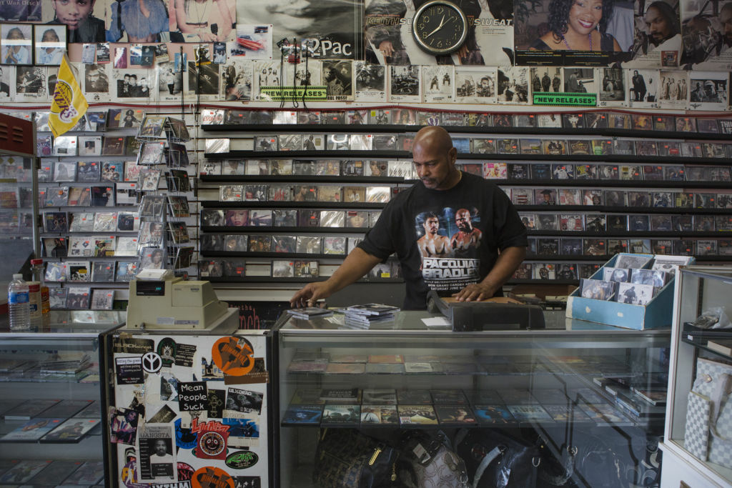 Kevin Harris, the manager of Spin-Off Music, thinks that the incoming Walmart could help bring customers into his CD, tape and record store.