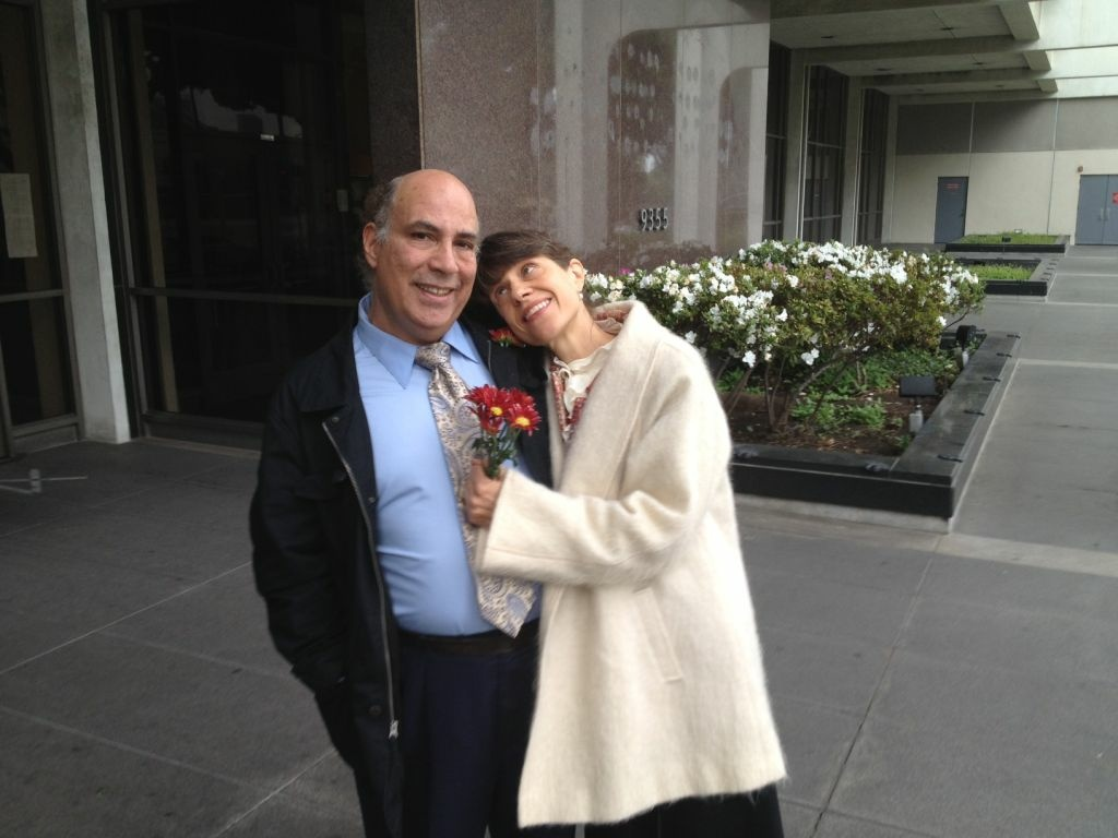Lisa Leist and Ron Hershewe wait giddily to get married in Beverly Hills on 12-12-12