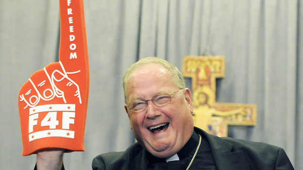 Cardinal Timothy Dolan of New York brandishes a foam finger promoting the