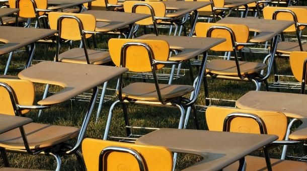 Empty school desks are ready for students to fill them.