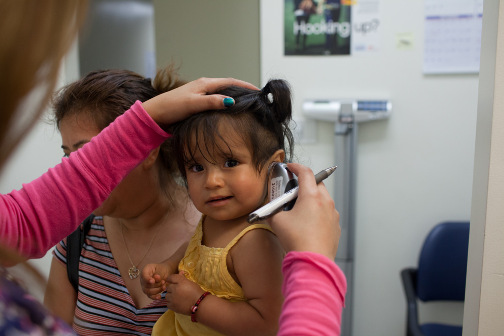 A doctor at South Central Family Health Center examines a patient on June 12th, 2012.