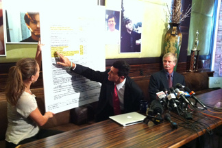 At a Los Angeles news conference, Attorney Garo Mardirossian points to medical records he says indicates  Fullerton homeless man Kelly Thomas died of brain injuries caused by head trauma.  Seated next to Mardirossian (right) is Thomas' father, Ron Thomas.