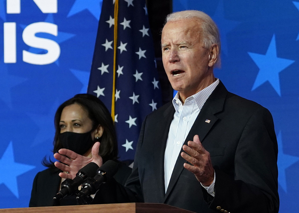 Former Vice President Joe Biden, joined by running mate Kamala Harris, gives remarks on Thursday in Wilmington, Del., his third day of waiting on vote counting.