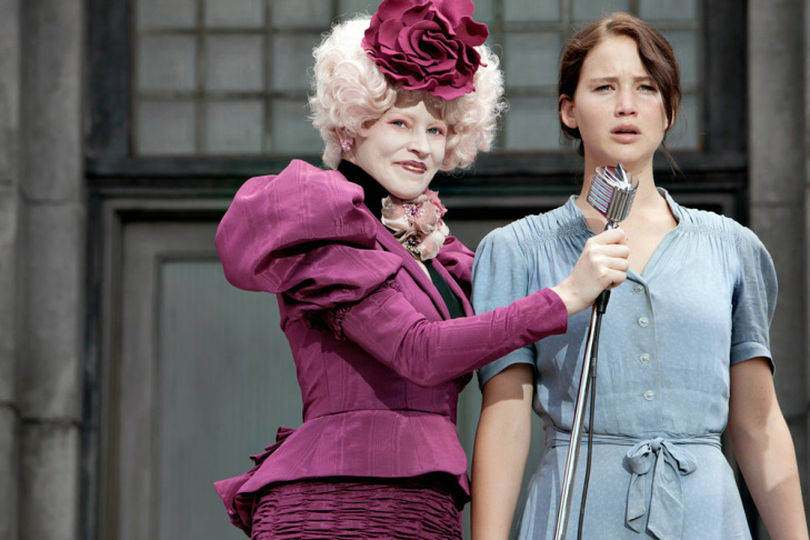 Effie Trinket (Elizabeth Banks, left) and Katniss Everdeen (Jennifer Lawrence) in