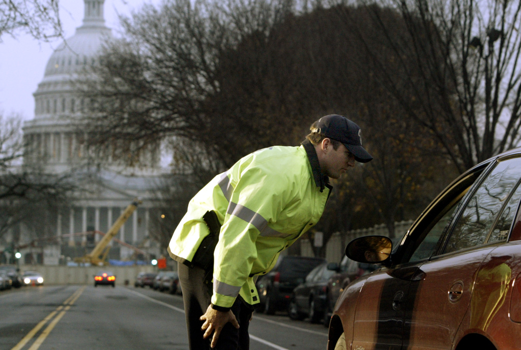 A U.S. Capitol Police officer stops a car on East Capitol Street in Washington, DC on November 19, 2004. The checkpoints around the U.S. Capitol are part of a temporary security perimeter that was set up around the U.S. Capitol in August.