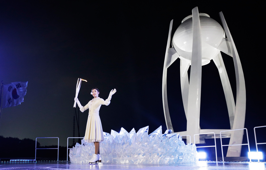 South Korean figure skater Yuna Kim prepares to light the cauldron during the Opening Ceremony of the Pyeongchang 2018 Winter Olympics on February 9, 2018.