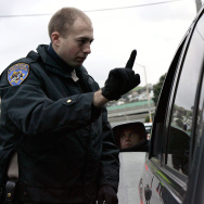 California Highway Patrol officer Mike Robinson gives a sobriety test to a man in car at a sobriety checkpoint December 26, 2004 in San Francisco, California.