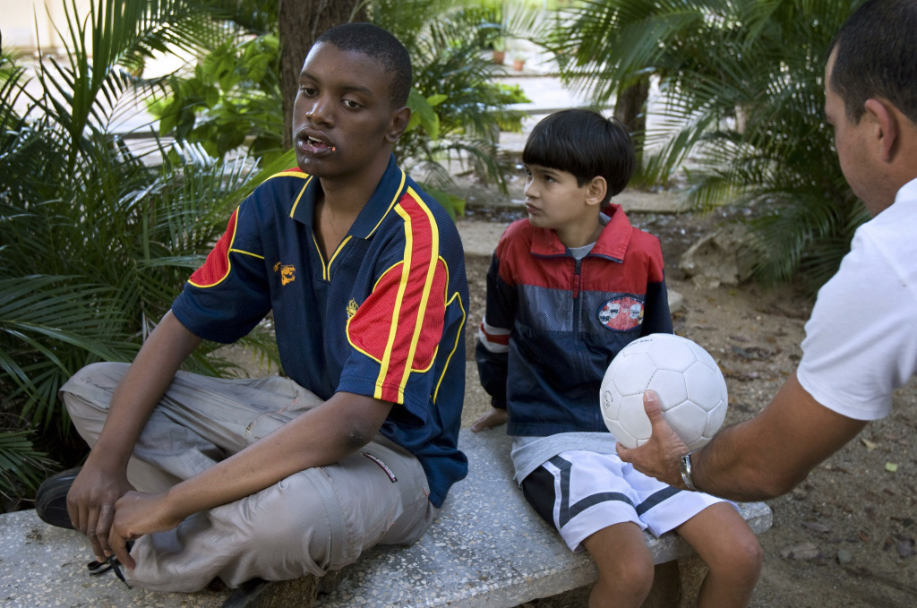 A therapist of Dora Alonso Special School gives a ball to an autistic child, on February 11, 2008, in Havana.