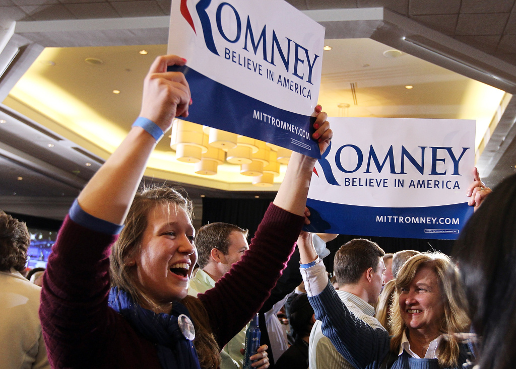 Supporters of Republican presidential candidate, former Massachusetts Gov. Mitt Romney  celebrate during a Super Tuesday night gathering on March 6, 2012 in Boston, Massachusetts.
