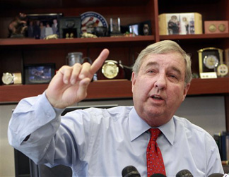 Los Angeles County District Attorney Steve Cooley announces his office will prosecute dispensaries that sell medical marijuana even if the Los Angeles City Council adopts an ordinance that does not ban such sales, during a news conference at his office in Los Angeles on Tueday, Nov. 17, 2009.