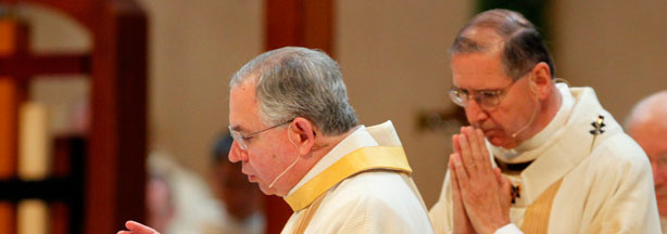 Archbishop Jose H. Gomez (C) and Cardinal Roger Mahony (R) take part in a welcoming Mass at the Cathedral of Our Lady of the Angels May 26, 2010 in downtown Los Angeles, California.