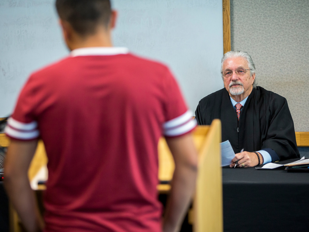 Hearing Officer Jim Teal presides over a session of Early Intervention Family Drug Court in Sacramento, Calif., in March. The county program helps keep families together — and saves taxpayers $7 million annually, Sacramento County officials say.