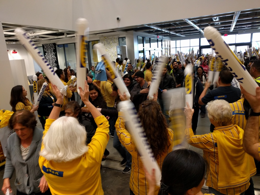 IKEA staffers welcome shoppers to the new store in Burbank with cheers and boomsticks.