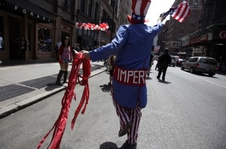 A man representing imperialism participates in a rally for jobs and immigration rights in New York on May 1, 2011.