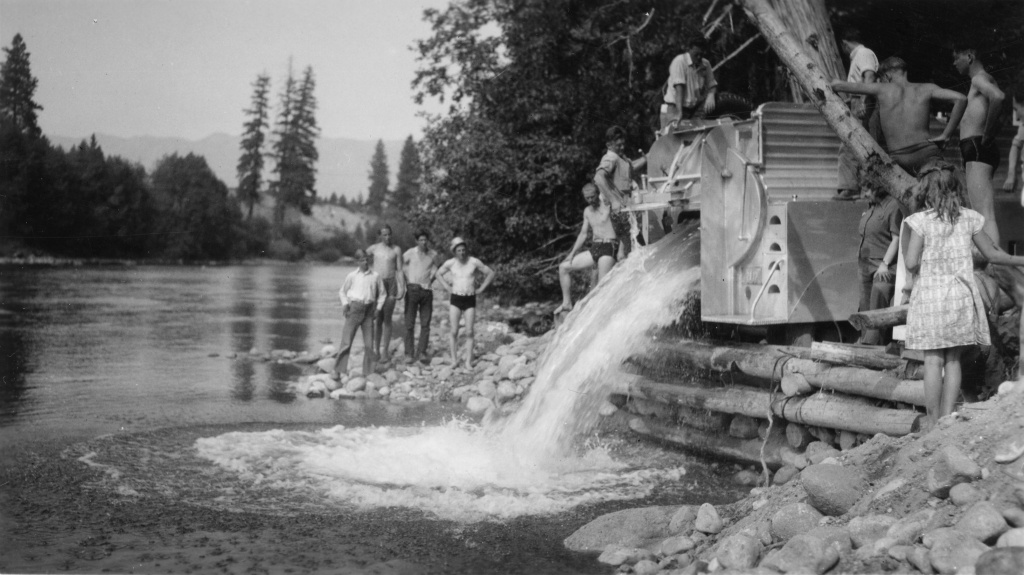 Moving fish around by truck, either to help them spawn, or to stock rivers for regional anglers, isn't new or special to the drought in California. This image shows a U.S. Bureau of Fisheries truck driver, John Manning, emptying his truck load of salmon at the Plain dump in Oregon's Wenatchee River.