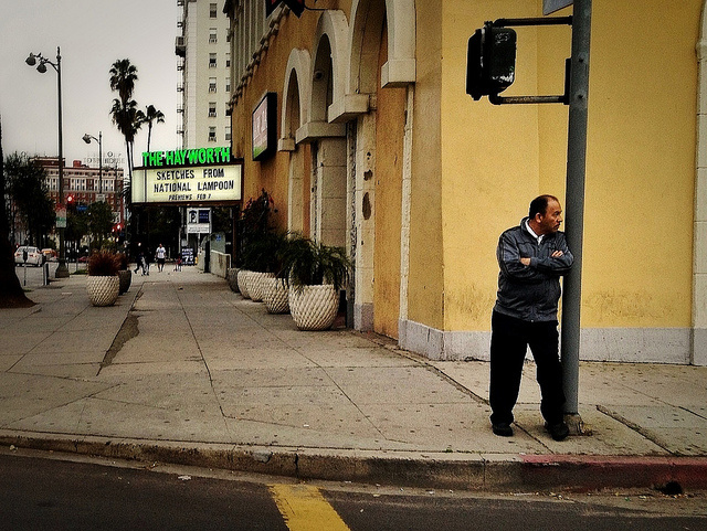 A man waits to cross Wilshire Boulevard in Los Angeles' Westlake neighborhood, a hub for Central American immigrants. The majority of U.S. immigrants with temporary protected status, known as TPS, are from Central America.