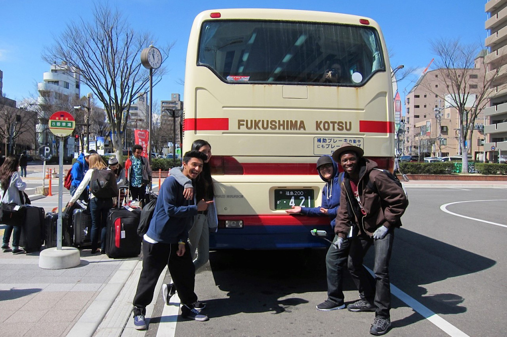 Members of YOLA pose behind a bus in Fukushima.
