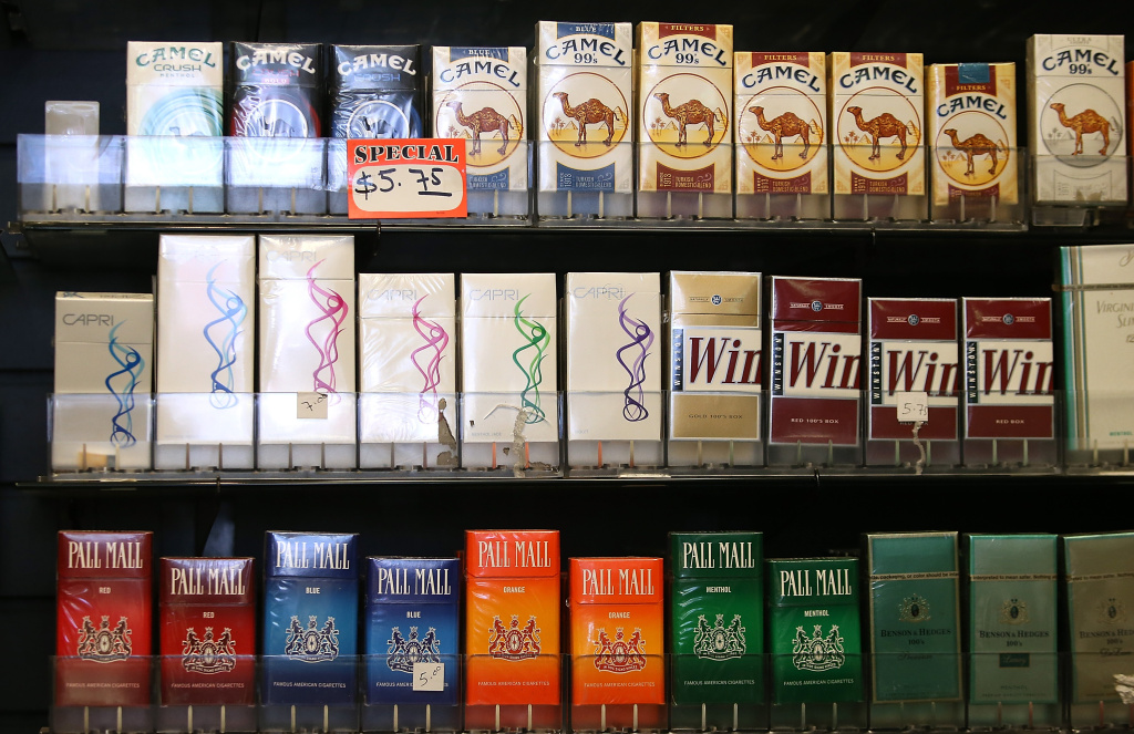 In this file photo, cigarette brands manufactured by Reynolds American are displayed at a tobacco shop on July 11, 2014 in San Francisco, California. On Thursday, the state Senate approved increasing the age limit on buying cigarettes to 21, despite intense lobbying from tobacco interests and fierce opposition from many Republicans.