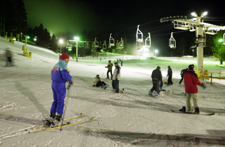 File: Skiers take advantage of well-lit slopes through the night at Mountain High ski resort, Jan. 24, 2001 near Wrightwood, California.