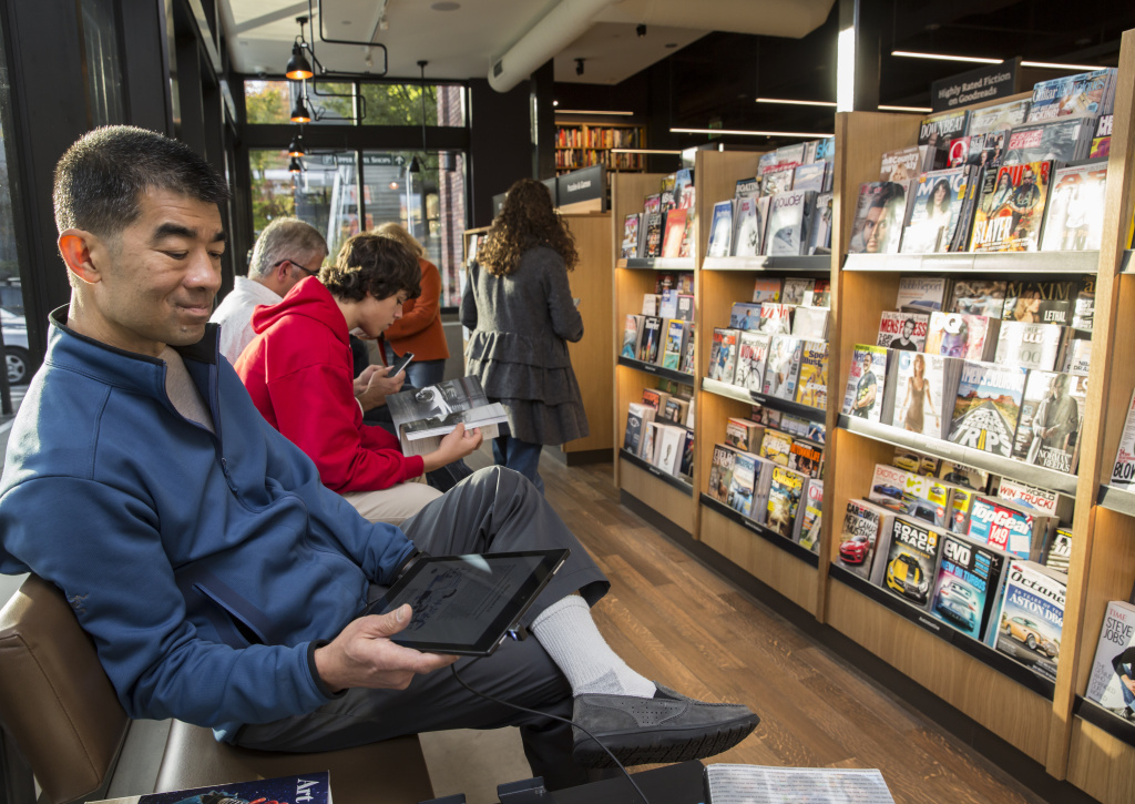 Jeff Ing of Seattle uses a Kindle Fire tablet device at the newly opened Amazon Books store on November 4, 2015 in Seattle, Washington.