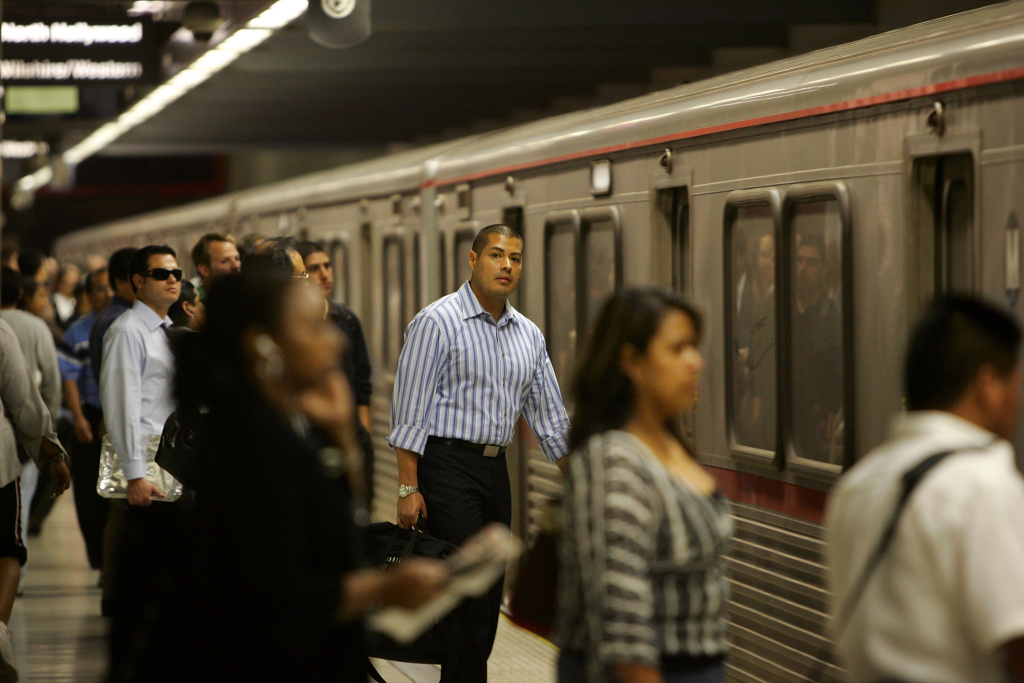 Passengers board Metrolink subway trains during rush hour on June 3, 2008 in Los Angeles, California. Skyrocketing gas prices are driving more commuters to take trains and buses to work instead of their cars.