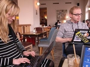 People work on laptops at Sankt Oberholtz cafe in Berlin.