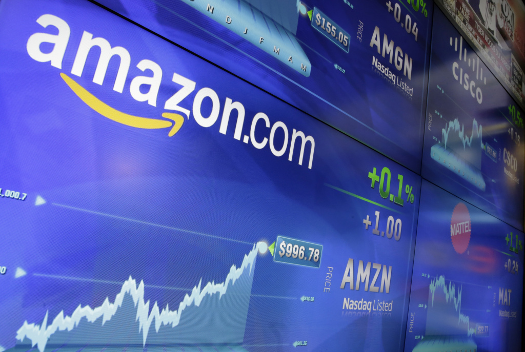 In this Tuesday, May 30, 2017, file photo, the Amazon logo is displayed at the Nasdaq MarketSite, in New York's Times Square. Amazon announced Tuesday, June 20, 2017, that it's testing a new service for its Prime members that lets customers try on the latest styles before they buy at no upfront charge, take seven days to decide and only pay for what they keep.