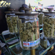 Jars of marijuana are on display for sale at the Cali Gold Genetics booth during the High Times Cannabis Cup in San Bernardino on April 23, 2017.