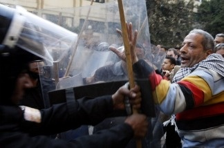 Egyptian demonstrators demanding the ouster of President Hosni Mubarak and calling for reforms face riot police in Cairo on January 26, 2011.