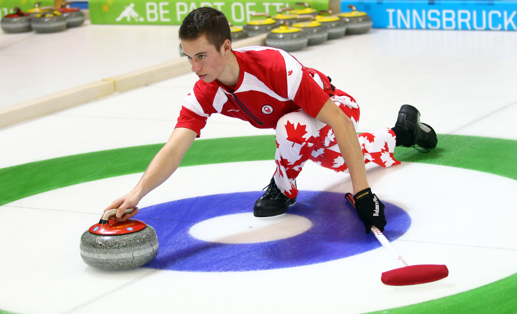 Derek Oryniak of Canada in action in the Mixed Doubles Curling at the Exhibition Centre during the Winter Youth Olympic Game on January 20, 2012 in Innsbruck, Austria.
