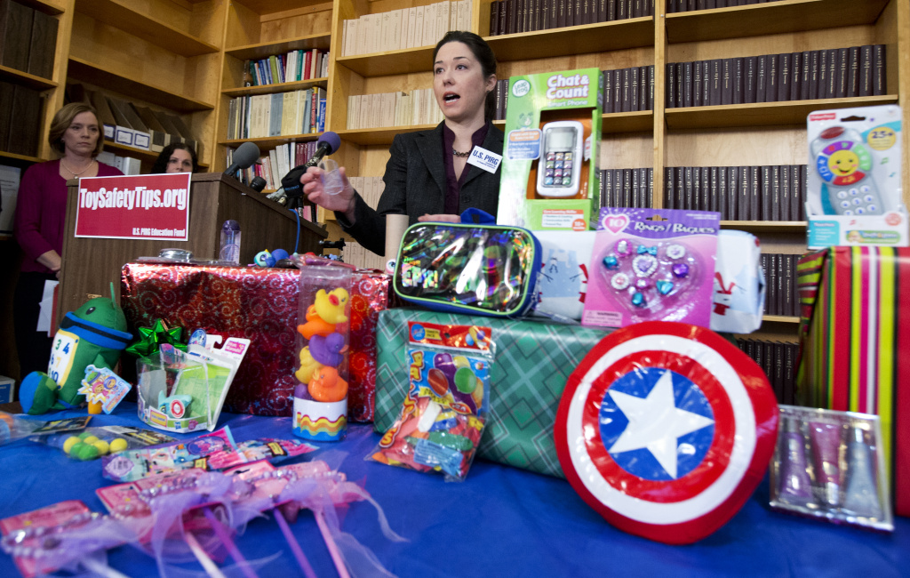 Jenny Levin, of U.S. PIRG Public Health Advocate, speaks during a news conference in Washington, Tuesday, Nov. 26, 2013, displaying a toy Captain America shield, right, together with others considered dangerous toys, according to U.S. PIRG's 28th annual Trouble in Toyland report.  Several toys with high lead levels or toys that could cause young children to choke were found at major retailers and discount stores in the last few months, the U.S. Public Interest Research Group said Tuesday. The consumer safety group analyzed 50 toys for its annual report. Violations were found in just under a dozen, including a Captain America toy shield and play jewelry. (AP Photo/Manuel Balce Ceneta)