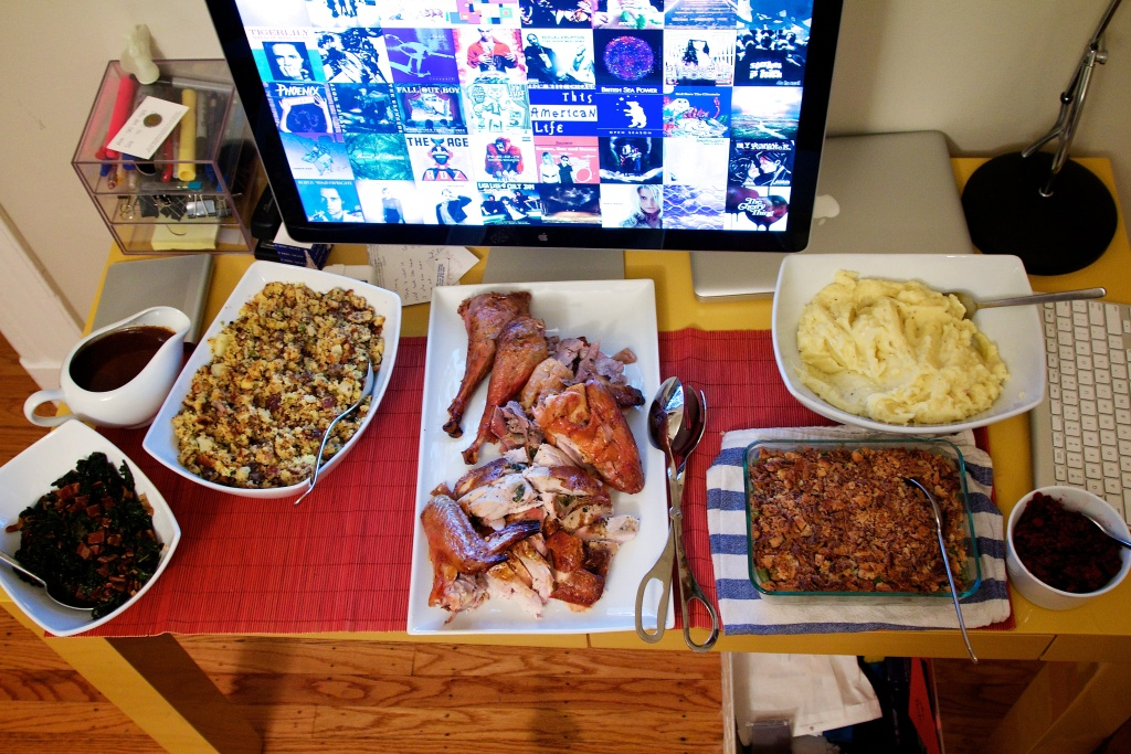 File: Thanksgiving dinner served on a computer desk.