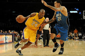 Kobe Bryant drives against Matt Barnes #22 of the Orlando Magic in the first quarter during the game on Jan. 18, 2010 at Staples Center in Los Angeles.